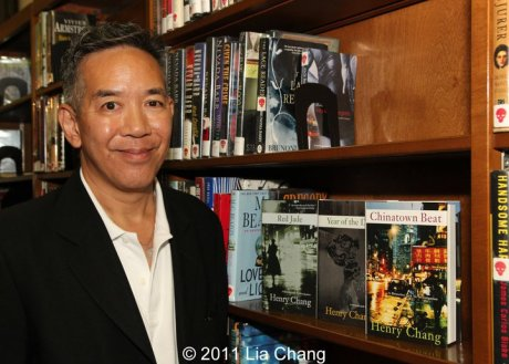 Henry Chang, author of the Chinatown Trilogy, in the Mystery Fiction section of the Mid-Manhattan Library.  Photo by Lia Chang