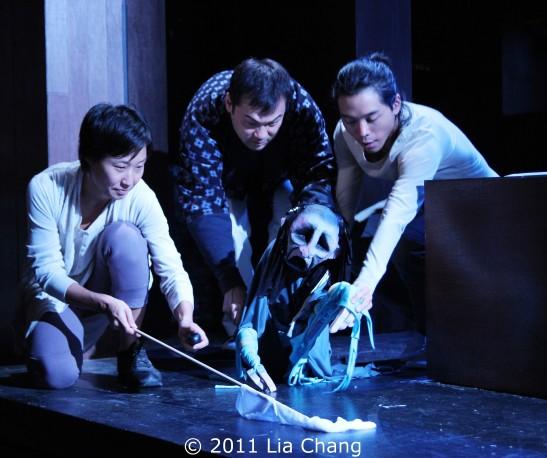 Susan Hyon, David Shih and Jake Manabat navigate their puppets. Photo by Lia Chang