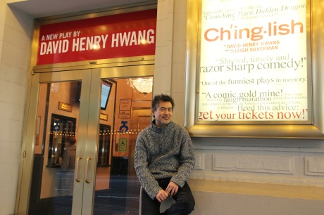 Playwright David Henry Hwang in front of the Longacre Theatre in New York, where his new comedy Chinglish is currently playing on Broadway. Photo by Lia Chang