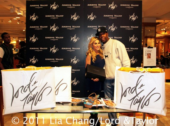 The Real Housewives of Beverly Hills' star Adrienne Maloof with Carlton P.Fletcher during a personal appearance at the Lord & Taylor Fifth Ave Flagship Store in New York to introduce her new Adrienne Maloof by Charles Jourdan Shoe Collection on December 17, 2011. Photo by Lia Chang/Lord & Taylor