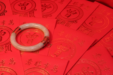 Jade Bracelet and Red Envelopes, 2009. Photo by Lia Chang