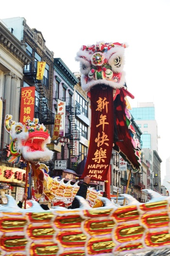 Lion and Dragon masks in Chinese New Year Parade, New YorkChinatown, 2002. (Lia Chang)