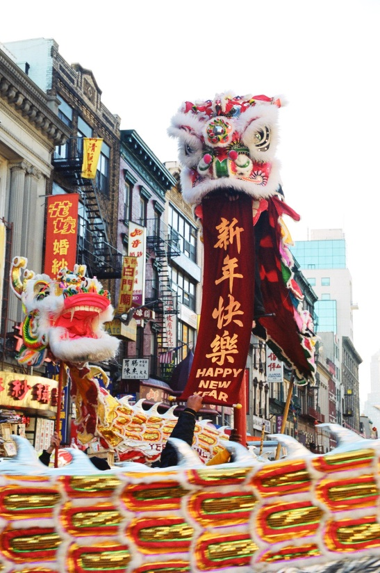 Lion and Dragon masks in Chinese New Year Parade, New York Chinatown, 2002. (Lia Chang)