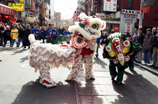 White and Black Lion Costumes in Chinese New Year Parade, New York Chinatown, 2002. (Lia Chang)