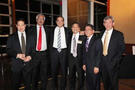AALDEF 2007 Justice in Action honoree Javade Chaudhri (second from left) and 2011 Justice in Action honoree AB Cruz III (fourth from the left) celebrate the Year of the Dragon with friends and colleagues at AALDEF's Lunar New Year Benefit at Pier Sixty, Chelsea Piers in New York on February 8, 2012. Photo by Lia Chang