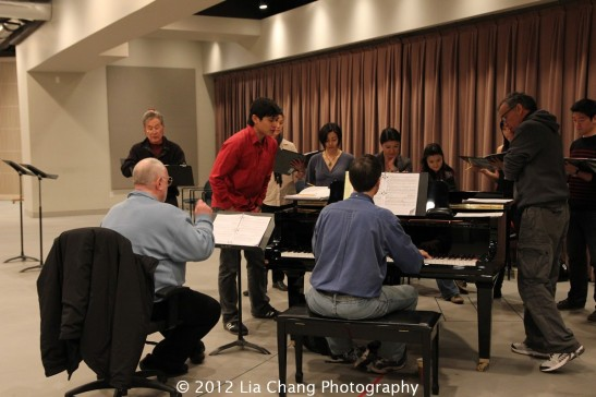 Musical director Paul Gemignani (seated far left) rehearses with the cast of Shinsai: Theaters for Japan in the Lincoln Center rehearsal hall on Friday, March 9, 2012. Photo by Lia Chang