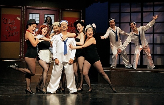 Randy Reyes and the cast of Mu Performing Arts' production of David Henry Hwang's revisal of Rogers and Hammerstein's Flower Drum Song. Photo by Michal Daniel.