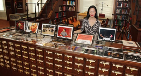 "Lia Chang with her Lia Chang Theater Portfolio ""In Rehearsal"" photographs on view through May 31, 2012, in the Library of Congress'  Asian Division Reading Room, in the Thomas Jefferson Building in Washington D.C, on May 5, 2012."