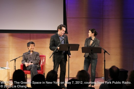 David Henry Hwang watches Brian d'Arcy James and Jennifer Lim in a scene from Chinglish at WNYC's The Greene Space in New York on May 7, 2012, courtesy New York Public Radio. © 2012 Lia Chang