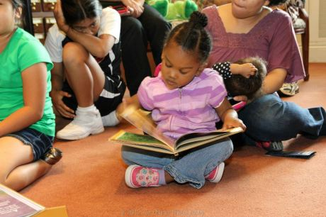 Sofia Escalante, age 4, of the Mabuhay Inc. Culture School reads a book by a Filipino author in the Library of Congress' Asian Division Reading Room in the Thomas Jefferson Building in Washington D.C. on May 5, 2012. Photo by Lia Chang
