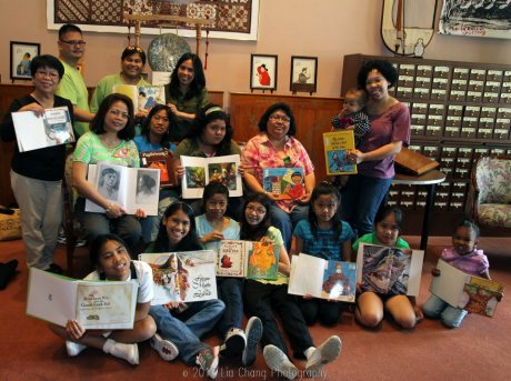 Members of the Mabuhay Inc. Culture School reads a book by a Filipino author in the Library of Congress' Asian Division Reading Room in the Thomas Jefferson Building in Washington D.C. on May 5, 2012. Photo by Lia Chang