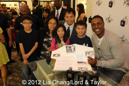 New York Yankees outfielder Curtis Granderson, the brand ambassador for the New York Yankees ™ Fragrance, poses with fans at Lord & Taylor Fifth Ave in New York on June 4, 2012. Photo by Lia Chang
