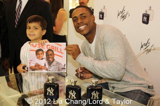 New York Yankees outfielder Curtis Granderson, the brand ambassador for the New York Yankees Fragrance, poses with fans at Lord & Taylor Fifth Ave in New York on June 4, 2012. Photo by Lia Chang/Lord & Taylor