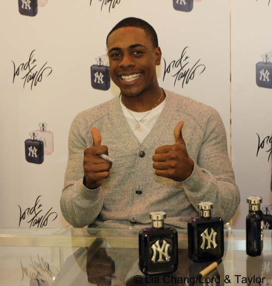 New York Yankees outfielder Curtis Granderson, the brand ambassador for the New York Yankees ™ Fragrance, at Lord & Taylor Fifth Ave in New York on June 4, 2012. Photo by Lia Chang