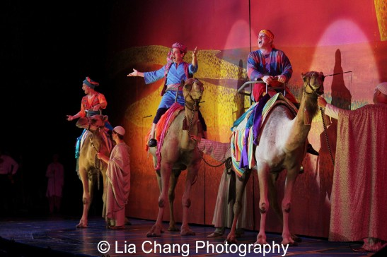Francis Jue, Jason Graae and Eddie Korbich open Disney's Aladdin on camels at The Muny in St. Louis. Photo by Lia Chang