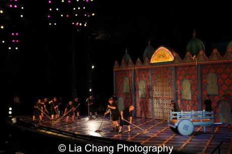 Stagehands mop The Muny stage during intermission after the lightening storm and shower.  Photo by Lia Chang