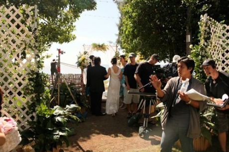On the set of 4 Wedding Planners with director Michael Kang. Photo courtesy of Island Film Group
