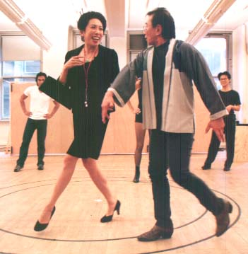 Jodi Long and Randall Duk Kim in a rehearsal of David Henry Hwang's revisal of Roger's and Hammerstein's Flower Drum Song in New York in 2002. Photo by Lia Chang