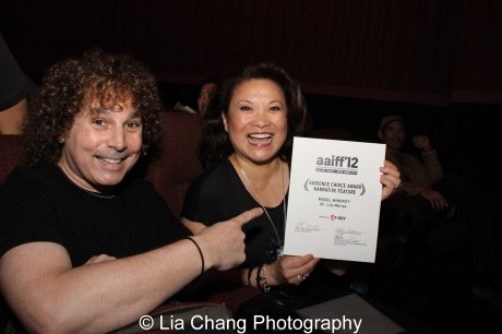 A Model Minority team: Three-time Grammy nominee, saxophonist Boney James shows off his wife's Audience Choice Award for Narrative Feature for Model Minority, at the 35th Asian American International Film Festival, at the Clearview Chelsea Cinemas in New York on August 5, 2012. Mariye, wrote, directed and shares producing credits with James, whose music is featured on the soundtrack. Photo by Lia Chang