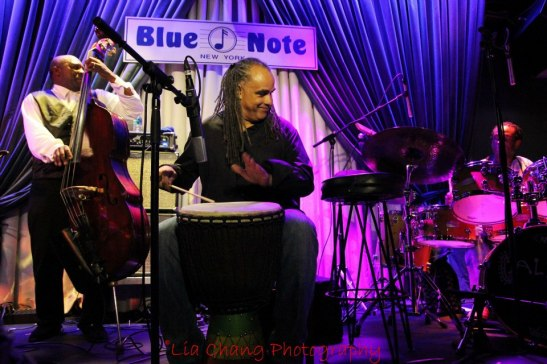Charnett Moffett, Mino Cinelu and Will Calhoun in performance at The Blue Note in New York on August 13, 2012. Photo by Lia Chang