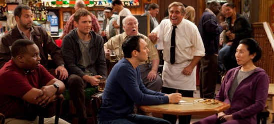(L-R) Steve Byrne as Steve Sullivan and Jodi Long as OK Cha, his mother, seated at table in a scene from Sullivan & Son. ( Photo courtesy of TBS)