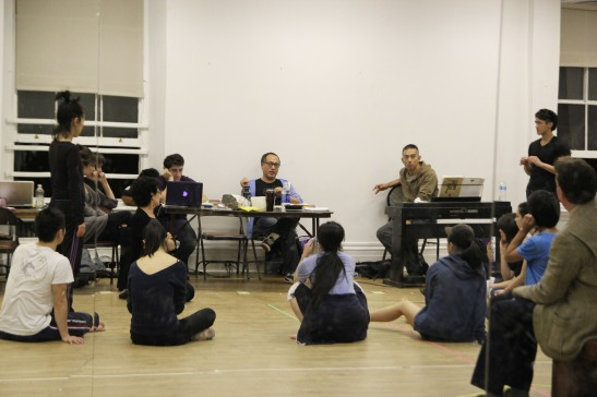 The King and I director Alan Muraoka gives notes after the runthru. Photo by Lia Chang