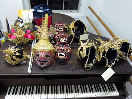 The mask and prop piano. Photo by Lia Chang