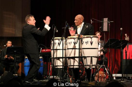 "On October 26, 2012, the legendary conguero Candido (now 91-years-young) performed with The Manhattan School of Music Afro-Cuban Jazz Orchestra now in its twelfth year under the direction of internationally renowned percussionist Bobby Sanabria. The Orchestra kicked off a year-long ""Harlem Nights"" Concert Series with ""Harlem Hothouses,"" a tribute to The Greater Harlem Chamber of Commerce, in The Manhattan School of Music's Borden Auditorium in New York. Photo by Lia Chang"