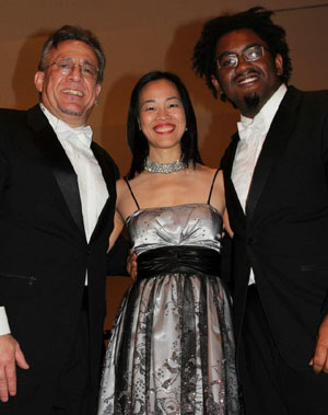 Percussionist and conductor Bobby Sanabria, Lia Chang and musician Patrick Bartley at  at the Manhattan School of Music's Harlem Hothouses Concert celebrating the Greater Harlem Chamber of Commerce in New York on October 26, 2012. Photo by Lorey Hayes