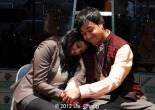 "Lipica Shah as ""Sunita"" and Debargo Sanyal as ""Mr. Scroogewala"" from LAUGHistan's World Premiere of ""BUMBUG The Musical"". Photo Credit: Lia Chang"