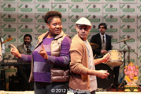 "Adrienne C. Moore as ""Angel"" and Andrew Ramcharan Guilarte as ""Scroogewala"" from LAUGHistan's World Premiere of ""BUMBUG The Musical"". Photo Credit: Lia Chang"