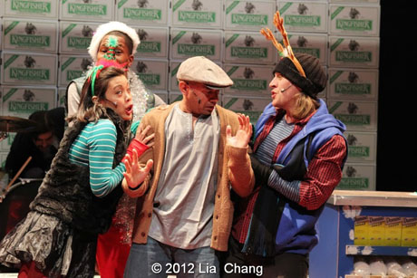 "Andrew Ramcharan Guilarte as ""Scroogewala"" (center) with the Angel Crew (left to right: Brooke Ishibashi, Kiarri Andrews & Matthew Knowland) from LAUGHistan's World Premiere of ""BUMBUG The Musical"". Photo Credit: Lia Chang"