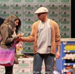 "Lipica Shah as ""Sunita"" and Andrew Ramcharan Guilarte as ""Scroogewala"" from LAUGHistan's World Premiere of ""BUMBUG The Musical"". Photo Credit: Lia Chang"