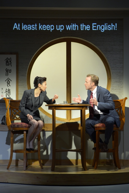 Michelle Krusiec (left) and Alex Moggridge (right) in South Coast Repertory's production of Chinglish, a new comedy from David Henry Hwang. This co-production with Berkeley Repertory Theatre – the West Coast premiere -- heads to the Hong Kong Arts Festival after the show closes at SCR. Photo courtesy of kevinberne.com