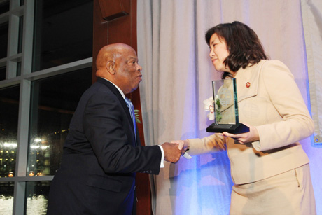 Rep. Grace Meng honors Rep. John Lewis. Photo by Lia Chang
