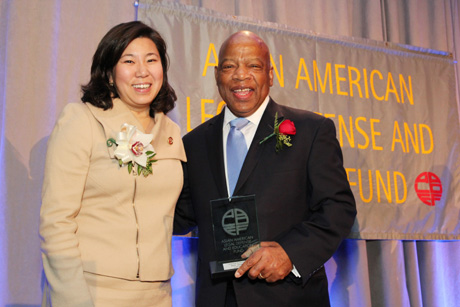 Rep. Grace Meng presents Rep. John Lewis with his Justice in Action award. Photo by Lia Chang