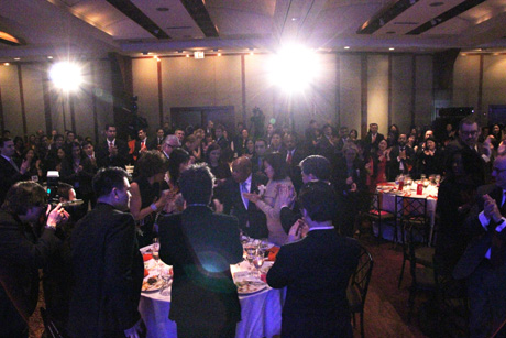 Standing ovation for Rep. John Lewis. Photo by Lia Chang