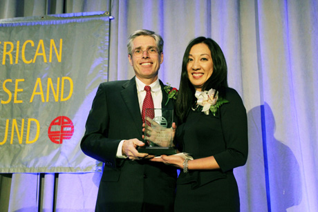 Gordon Smith, CEO of Consumer and Community Banking, JPMorgan Chase presents Honoree Simone Wu with her Justice in Action award. Photo by Lia Chang