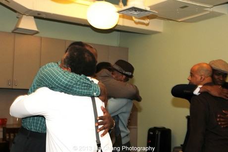 Two Trains Running pre-show hug. Photo by Lia Chang