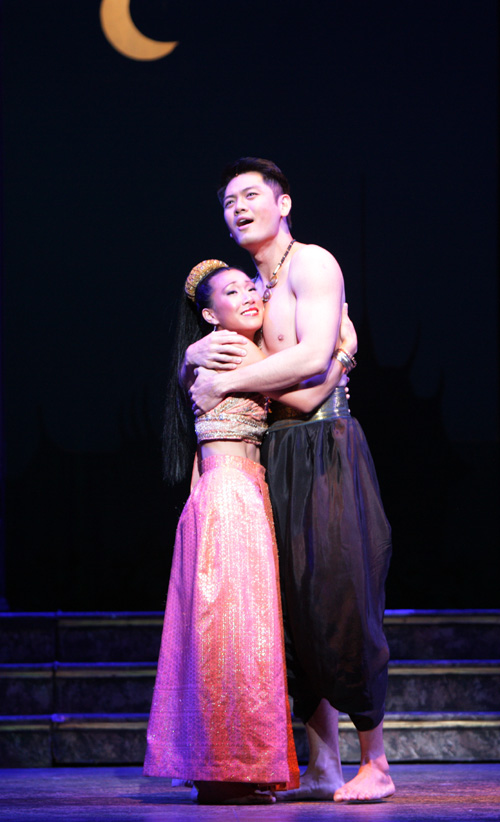Kay Trinidad  as Tuptim and Karl Josef Co as Lun Tha. Photo by Christopher Clark, Music Theatre of Wichita
