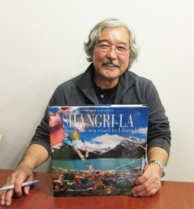 National Geographic photographer Michael Yamashita at a book signing at the Asia Society on February 21, 2013 for his new book Shangri-LA. Photo by Lia Chang