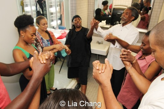 The cast of Knock Me A Kiss backstage during their prayer circle at the Gerald Freedman Theatre in Winston-Salem, North Carolina on August 1, 2013. Photo by Lia Chang
