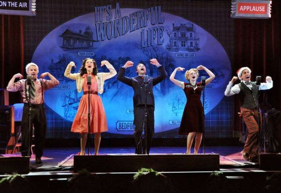 "From left, Mark Price, Jill Paice, Justin Guarini, Lauren Molina, and Garth Kravits in ""It's a Wonderful Life: A Live Radio Play."" (MANDEE KUENZLE / Bucks County Playhouse)"