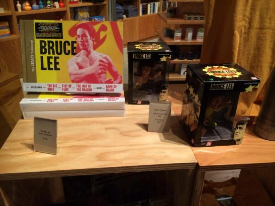 The Signature Theatre Company Bookstore is currently stocking Bruce Lee themed merchandise including Bruce Lee DVD sets, Bruce Lee Dolls and Bruce Lee/Kung Fu themed T-shirts. Photo by Lia Chang