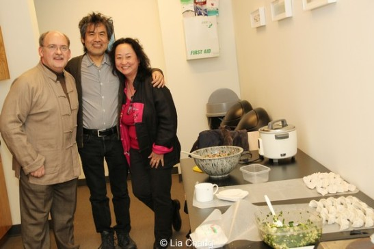 David Henry Hwang visits his cultural consultants, husband and wife team, Ken Smith and Joanna C. Lee in the Signature Theatre kitchen, where they were making dumplings to celebrate the Year of the Horse.  Photo by Lia Chang
