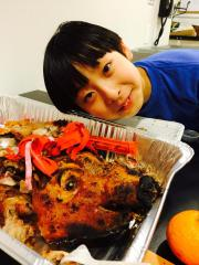 Bradley Fong and the good luck pig head. Photo by Lia Chang