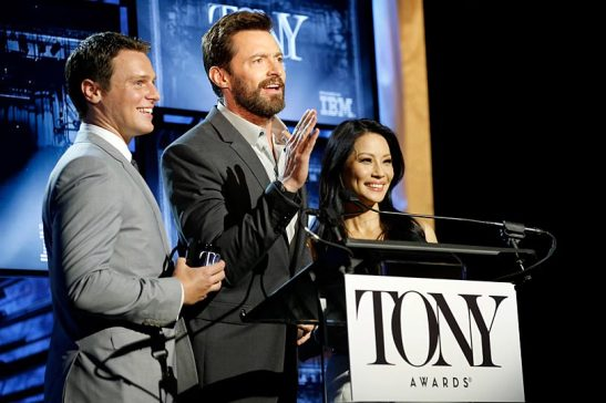 2014 Tony Awards host Hugh Jackman (center) makes a surprise appearance at the Nominations Announcement, hosted by Jonathan Groff (l.) and Lucy Liu (r.) at the Paramount Hotel on April 29, 2014, sponsored by IBM. Photo courtesy of The Tony Awards.