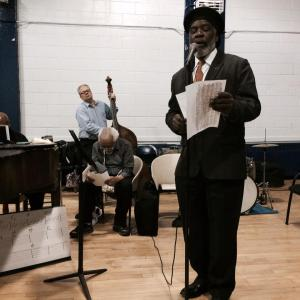 Rome Neal takes his turn at the mic during Barry Harris' (seated)  Jazz Vocals Workshop at the Lincoln Square Neighborhood Community Center in New York on March 11, 2014. Photo by Lia Chang