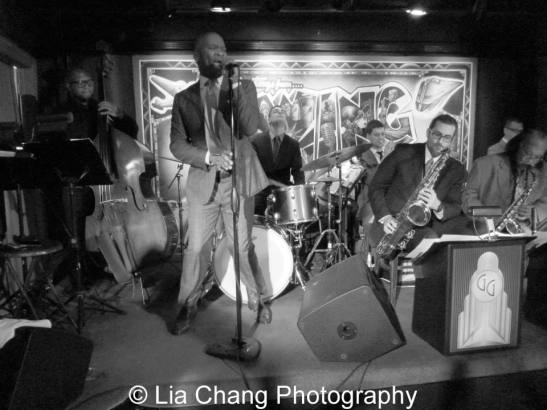 John Dokes at the mic with George Gee and the cats, who hold court every Tuesday at SWING46 in Times Square. Photo by Lia Chang