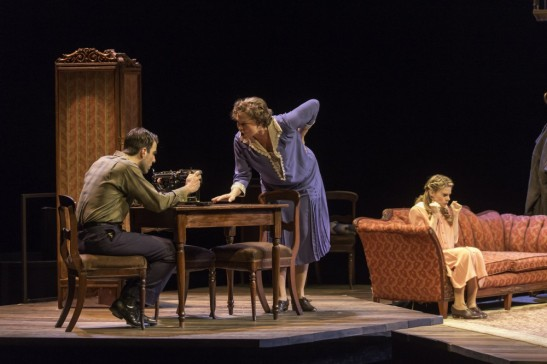 "Zachary Quinto as Tom, Cherry Jones as Amanda Wingfield, and Celia Keenan-Bolger as Laura in  ""The Glass Menagerie."" Photo credit: Michael J. Lutch"